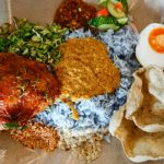 Unique things to do in Malaysia includes eating local Malaysian food