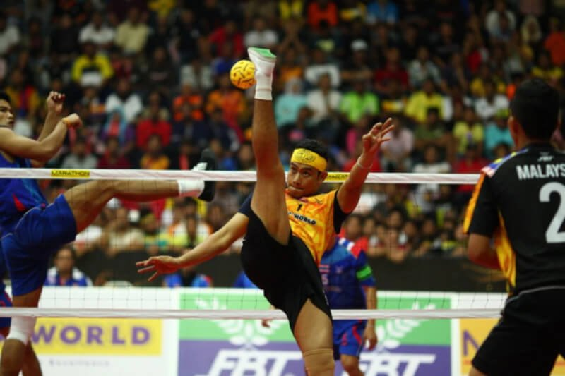 Malaysians playing their national sport Sepak Takraw