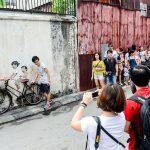 tourists penang street art